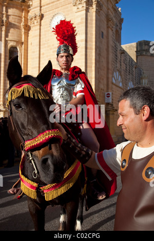 A Roman general mounted on a stallion takes part in traditional pageantry and parade in Xaghra town in Malta on - Stock Photo