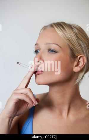 woman smoking a cigarette - Stock Photo