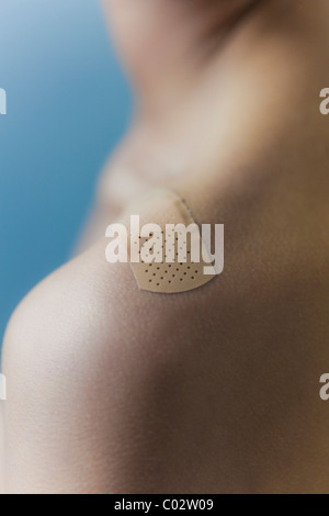 a patch on the shoulder of a woman - Stock Photo
