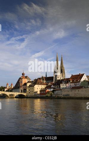 View across the Danube River looking towards the historic district, Steinerne Bruecke bridge, Brueckturm tower - Stock Photo