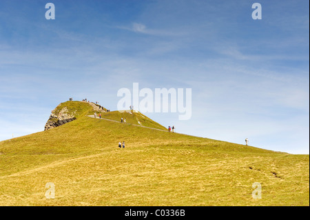 Tourists on the 2334 metre high summit of Maennlichen Mountain in the Bernese Alps, Canton of Bern, Switzerland, - Stock Photo