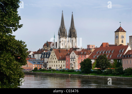 Historic district, view across the Danube River, Weinlaende harbour, the historic Rathausturm tower and Regensburg - Stock Photo