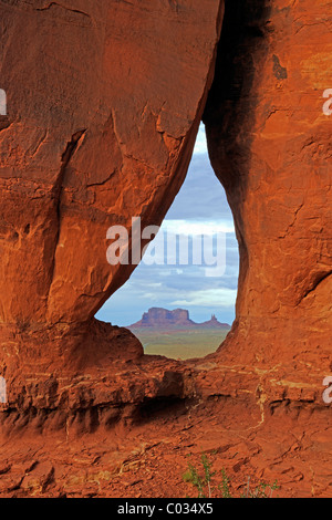 Looking through the Tear Drop Arch towards the Mesas in Monument Valley, Arizona, USA - Stock Photo