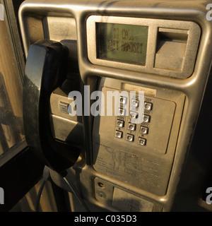 Inside a British Telecom telephone box. - Stock Photo