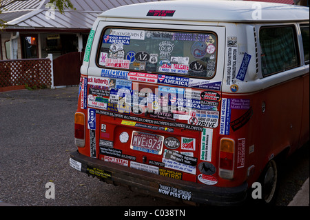 Back of old vw bus expresses many opinions on everything with bumper stickers stock
