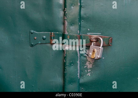 Padlocked gate latch - Stock Photo