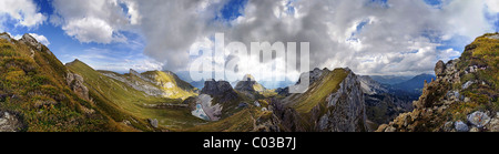 360° view from Seekarlscharte Mountain with Gruba Lake and bizarre clouds in the sky over the Rofan Mountains, Achensee, - Stock Photo