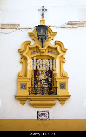 Religious tiled picture/icon set into wall next to Postigo del Aceite (gate in old city walls) Calle dos de Mayo, - Stock Photo