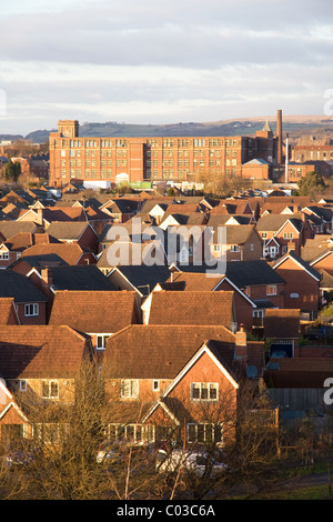 Modern housing estate and old cotton mill (Pilot Mill) with moors beyond, Bury, Greater Manchester, UK - Stock Photo