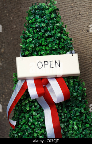 Shop open sign decorated with a bow, North Rhine-Westphalia, Germany, Europe - Stock Photo