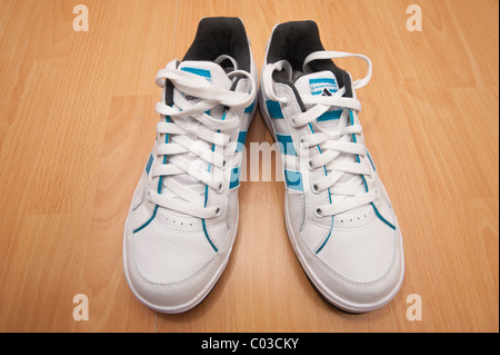 A picture of a brand new pair of adidas lace up training shoes ( trainers ) - Stock Photo