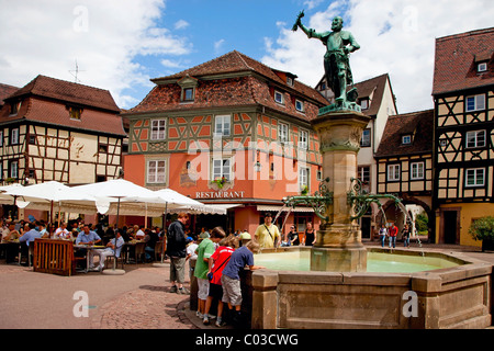 Fountain in front of old half-timbered houses, square in Colmar, Alsace, France, Europe - Stock Photo