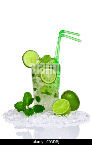 Photo of a Mojito cocktail with fresh lime and mint leaves isolated on a white background. - Stock Photo