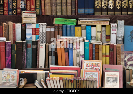 Books, display of bound books in a German antique book store - Stock Photo