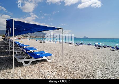 Empty blue chairs, umbrellas, pebble beach, Albir, Altea, Costa Blanca, Alicante, Spain, Europe - Stock Photo