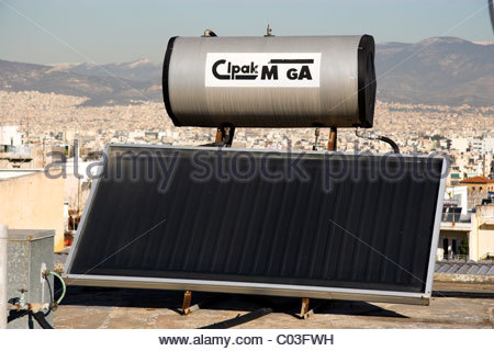 A Solar Water Heating Panel With Water Tank On The Roof Of