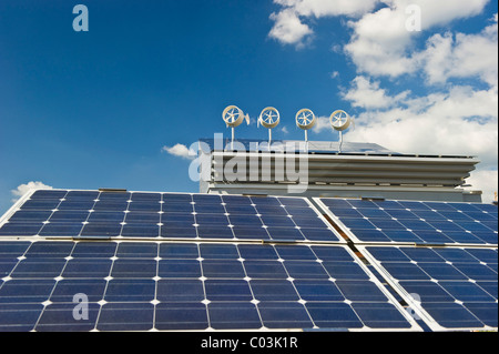 Small wind turbines and solar panels - Stock Photo