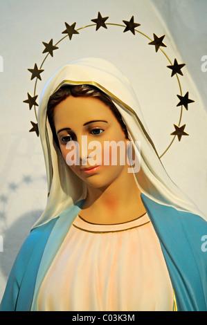 The Virgin Mary, statue of a saint, gloriole with stars, church of Saint Gertrude, Ibiza island, Pityuses, Balearic - Stock Photo