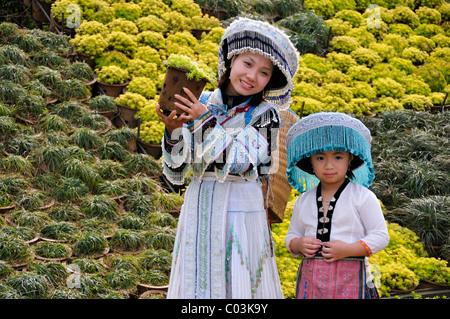Tourists wearing a traditional costume, Sapa, Vietnam, Asia - Stock Photo