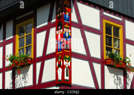 Wood carvings of typical Christmas motifs at the timber of a traditional half-timbered house, Seiffen, Saxony, Germany - Stock Photo