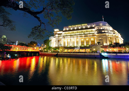 The Fullerton Hotel decked in festive lights during the Chinese New Year celebration in Singapore. - Stock Photo