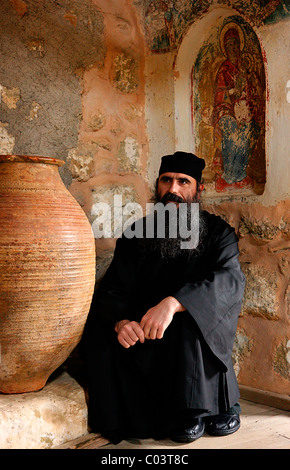 A Greek Orthodox monk in Aghia Triada ('Holy Trinity') monastery, Meteora, Greece. - Stock Photo