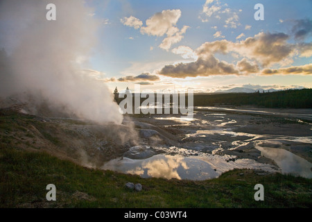 Black Growler steam vent and view over Porcelain Basin, Norris geothermal area, Yellowstone national park, Wyoming, - Stock Photo