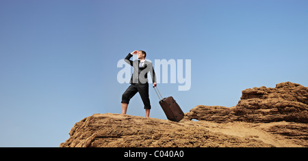Full length portrait of a lost businessman searching for a way - Stock Photo