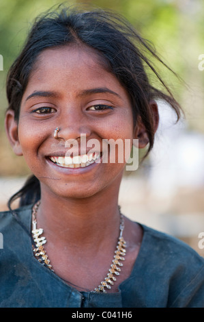 Happy young poor lower caste Indian street teenage girl smiling. Andhra Pradesh, India - Stock Photo