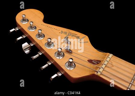 Fender American Standard Stratocaster headstock on black background - Stock Photo