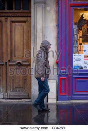 People walking - Paris France man rain wet - Stock Photo