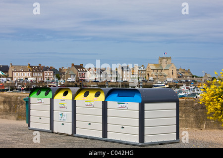 Large plastic recycling bins, dechetterie, for plastic, paper, glass spoil the view in Barfleur in Normandy, France - Stock Photo