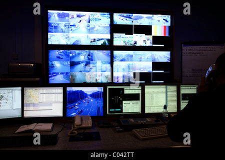 CCTV traffic enforcement scheme within the UK staying within the current legalframework. control room city. TV monitors. - Stock Photo