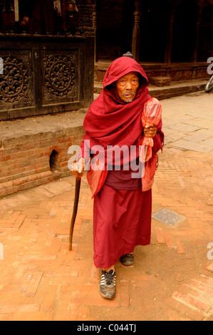 old hermit living among old buildings , peoples lives ( the nepalis ) ,  life in kathmandu , kathmandu street life - Stock Photo