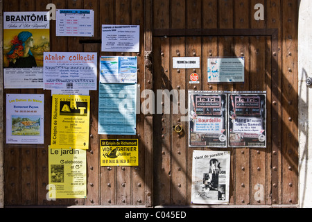Posters in quaint town of Bourdeilles popular tourist destination near Brantome in Northern Dordogne, France - Stock Photo