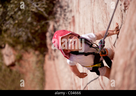 Little girl rock climbing in Red Rock Canyon National Conservation Area, Nevada, USA - Stock Photo