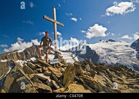Summit cross on the Lesser Troll, along the Stubai Hohenweg. - Stock Photo