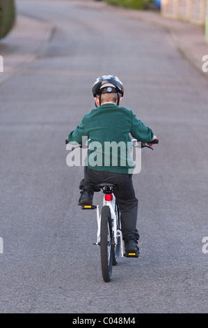 A MODEL RELEASED seven year old boy riding his BMX bike in the Uk - Stock Photo