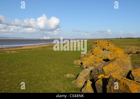 Lower River Severn Estuary with Sea defences and Oldbury Nuclear Power Station in the distance - Stock Photo