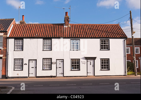 A row of pretty cottages in Southwold , Suffolk , England , Britain , Uk - Stock Photo