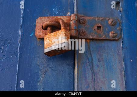 A close up of a rusty padlock - Stock Photo