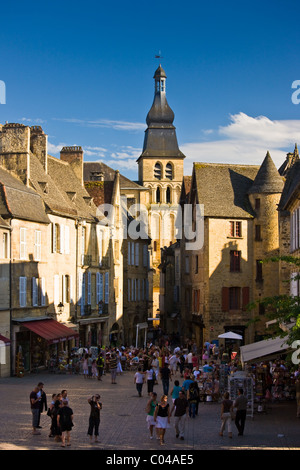 Centre Ville, tourists in town square of popular picturesque tourist destination of Sarlat in the Dordogne, France