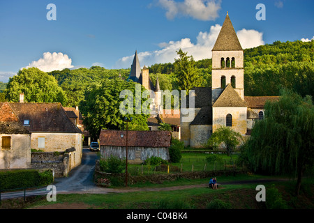 Courting couple in the village of St Leon sur Vezere in the Dordogne, France - Stock Photo