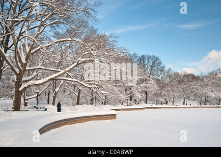 The Model Boat Pond, also known as the Conservatory Water, in Central Park, NYC after a snowfall - Stock Photo