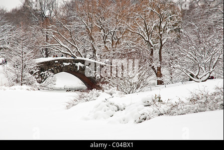 Gapstow Bridge in Central Park, NYC after a Snowstorm - Stock Photo