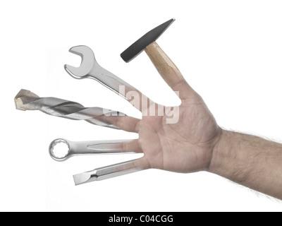 Handyman hand full of tools on white background - Stock Photo