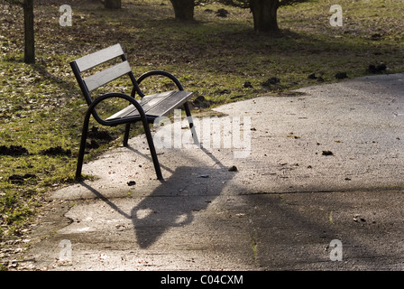The photography of empty bench in the park square. Taken on January 2011. - Stock Photo