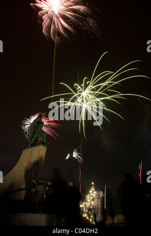 Fireworks on New Years Eve by the statue of Leif Erikson in Reykjavik, Iceland. - Stock Photo