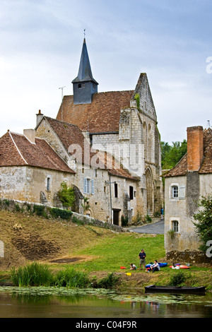 People with kayaks in traditional medieval village of Angles Sur L'Anglin, Vienne, near Poitiers, France - Stock Photo