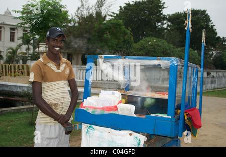 A salesman on the road selling snacks Jaffna Sri Lanka - Stock Photo